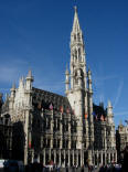 The Stadhuis (City Hall) in Brussels was built in the Gothic style. Parts of the structure date back to the early 15th century. Its spire is topped by a gilt metal statue of the Archangel Michael, patron saint of Brussels. The facade is decorated with statues of nobles, saints, and allegorical figures.